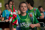 "A boy carries the baton as he runs on the 20th Korrika. Erratzu (Basque Country) April 3, 2017. The ""Korrika"" is a relay course, with a wooden baton that passes from hand to hand without interruption, organised every two years in a bid to promote the basque language. The Korrika runs over 11 days and 10 nights, crossing many Basque villages and cities, totalling some 2300 kilometres. Some people consider it an honour to carry the baton with the symbol of the Basques, ""buying"" kilometres to support Basque language teaching. (Gari Garaialde / Bostok Photo)"