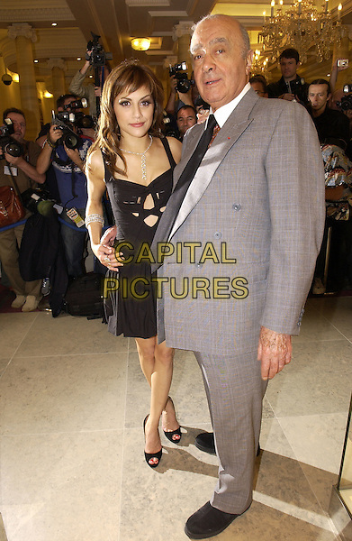 BRITTANY MURPHY & MOHAMED AL FAYED .Opens the Harrods Summer Sale, .Knightsbridge, London, June 27th 2005..full length arm around black Di Milo dress cut out Christian Louboutin peep toe shoes.Ref: FIN.www.capitalpictures.com.sales@capitalpictures.com.©Steve Finn/Capital Pictures.