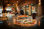 A photo of pizza, wings and beer at the Tamarack Brewing Company Restaurant in Montana