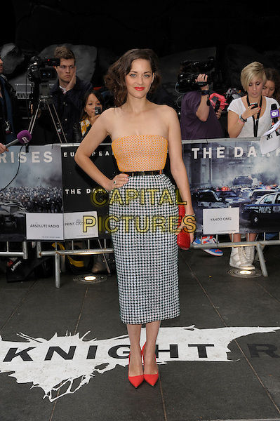 Marion Cotillard (in Christian Dior Couture).'The Dark Knight Rises' European premiere at Odeon Leicester Square cinema, London, England..18th July 2012.full length orange strapless top hand on hip gold metal waistband white black pattern skirt red clutch bag shoes.CAP/PL.©Phil Loftus/Capital Pictures.
