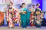 February 18, 2012, Tokyo, Japan - Contestants shows off their kimonos on stage during the 2012 Kimono Queen Contest. Approximately 500 women dressed in beautifully designed kimonos participate in this annual event for a chance to win special prizes and given the opportunity to be recognized as a kimono model in various media outlets. (Photo by Christopher Jue/AFLO)