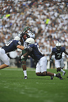 01 September 2012:  Penn State LBs Glenn Carson (40) and Gerald Hodges (6) hit Ohio TE Troy Hill (11). The Ohio Bobcats defeated the Penn State Nittany Lions 24-14 at Beaver Stadium in State College, PA..