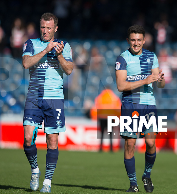 Garry Thompson and Luke O'Nien of Wycombe Wanderers at full time during the Sky Bet League 2 match between Wycombe Wanderers and Doncaster Rovers at Adams Park, High Wycombe, England on 22 April 2017. Photo by James Williamson / PRiME Media Images.