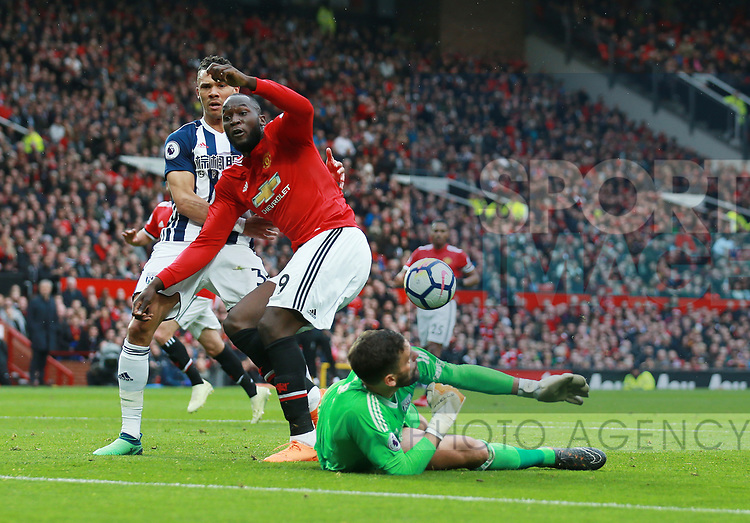 Ben Foster of West Bromwich Albion saves with his face from Romelu Lukaku of Manchester United during the premier league match at the Old Trafford Stadium, Manchester. Picture date 15th April 2018. Picture credit should read: Simon Bellis/Sportimage