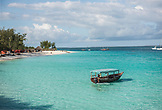 ZANZIBAR, Nungwi Beach, a Fisherman in his boat during Tide time. More boats in the background
