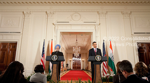 Washington, DC - November 24, 2009 -- United States President Barack Obama, right, speaks during a news conference with Manmohan Singh, India's prime minister, in the East Room of the White House in Washington, D.C., U.S., on Tuesday, November 24, 2009. Singh was welcomed to the White House this morning by Obama for a state visit where the two leaders will have discussions on curbing nuclear weapons, climate change and trade. .Credit: Andrew Harrer - Pool via CNP