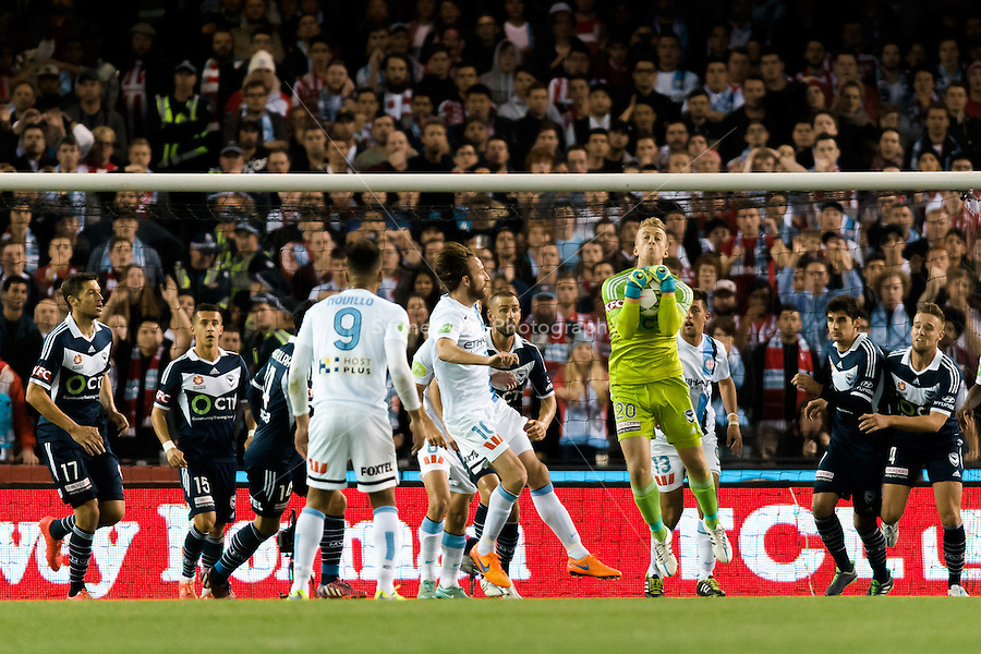 Lawrence Thomas of the Victory makes a save in the semi final match between Melbourne Victory and Melbourne City in the Australian Hyundai A-League 2015 season at Etihad Stadium, Melbourne, Australia.<br />