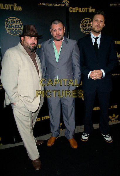FUN LOVIN' CRIMINALS.The Gumball 3000 Miles - film premiere, KOKO, London, UK..November 30th, 2006.full length black grey gray beige suit hat Loving.CAP/CAN.©Can Nguyen/Capital Pictures