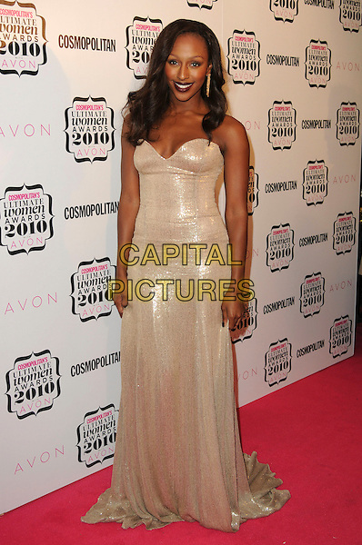 ALEXANDRA BURKE.Cosmopolitan Ultimate Women Of The Year Awards, Banqueting House, Whitehall Place, London, England..November 2nd, 2010.full length gold beige strapless shiny dark red lipstick maxi dress  .CAP/CAS.©Bob Cass/Capital Pictures.