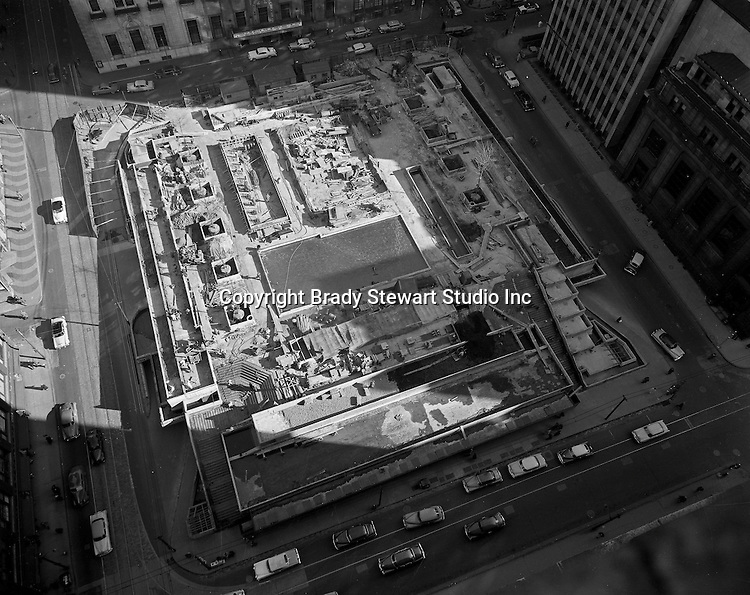 View of Mellon Square Construction from the roof of Kaufmann's department store - 1955. Mellon Square, built in 1953-55 was designed by Mitchell & Ritchey, landscaped by Simonds & Simonds, and paid for by Mellon family foundations.  Rumor has it that the park was built to keep Alcoa Corporation from moving from Pittsburgh to New York City in the early 1950s.  Other building in the photo include:  William Penn Hotel.