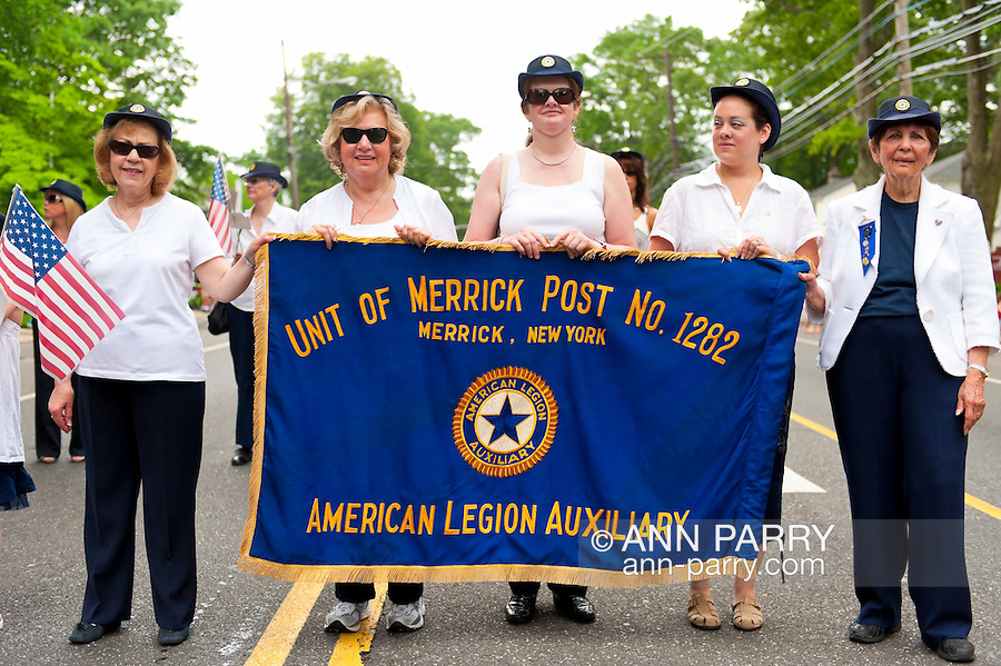 American Legion Auxiliary marching with banner in Merrick Memorial Day Parade on May 28, 2012, on Long Island, New York, USA. America's war heroes are honored on this National Holiday.