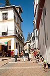 People walking narrow streets Albaicin district, Granada, Spain
