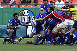 30 April 2005: Kansas City's Vince Pastorino makes a pass as Philadelphia's Gregory Dowse defends. The Kansas City Blues defeated the Philadelphia Whitemarsh RFC 41-14 at the Arrowhead Stadium in Kansas City, Missouri in a Rugby Super League regular season game. .