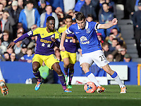 Pictured L-R: Nathan Dyer of Swansea closely marking Seamus Coleman of Everton. Sunday 16 February 2014<br /> Re: FA Cup, Everton v Swansea City FC at Goodison Park, Liverpool, UK.