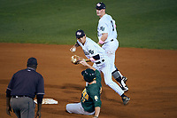 Stetson Hatters shortstop Matt Morales (7) throws to first base as Jordan Folgers (12) slides into second base with Jack Machonis (3) backing up the play during a game against the Siena Saints on February 23, 2016 at Melching Field at Conrad Park in DeLand, Florida.  Stetson defeated Siena 5-3.  (Mike Janes/Four Seam Images)