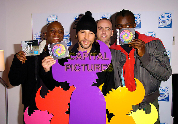 JAY KAY & JAMIROQUI.At their album Launch & CD Signing, PC World,.Tottenham Court Road, London, England,.November 18th 2006..half length music band group.CAP/CAN.©Can Nguyen/Capital Pictures