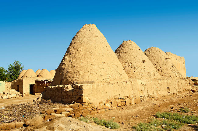 """Pictures of the beehive adobe buildings of Harran, south west Anatolia, Turkey.  Harran was a major ancient city in Upper Mesopotamia whose site is near the modern village of Altınbaşak, Turkey, 24 miles (44 kilometers) southeast of Şanlıurfa. The location is in a district of Şanlıurfa Province that is also named """"Harran"""". Harran is famous for its traditional 'beehive' adobe houses, constructed entirely without wood. The design of these makes them cool inside. 35"""