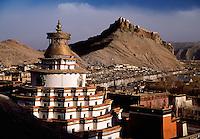 View to Gyantse Dzong old fort with Kumbum Stupa in foreground Gyantse Tibet China.