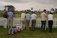 July 6th, 2006. Smurfit European Open, The K Club, Straffan, County Kildare..The humidity is all too much for this punter at the practise green..Photo: BARRY CRONIN/Newsfile..(Photo credit should read BARRY CRONIN/NEWSFILE).