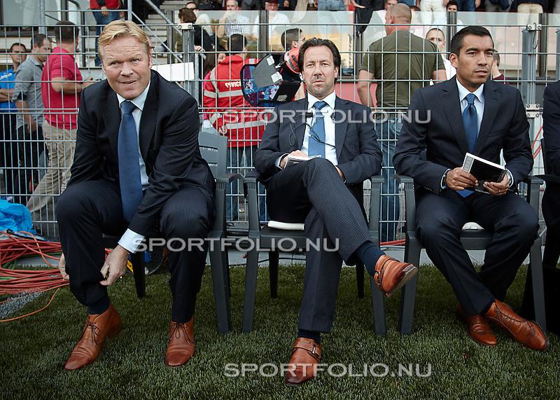 Nederland, Rotterdam, 5 augustus 2011.Eredivisie .Seizoen 2011-2012.Excelsior-Feyenoord (0-2) .Technische staf van Feyenoord. V.l.n.r.: Ronald Koeman, Jean-Paul van Gastel en Giovanni van Bronckhorst
