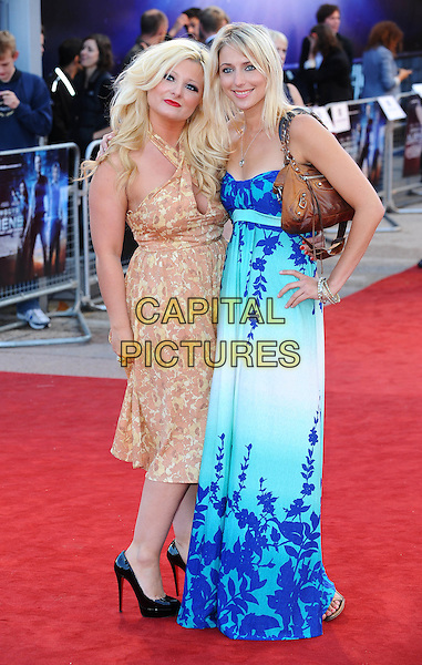 "SINEAD KELLY & ALI BASTIAN.The UK Premiere of ""Cowboys And Aliens"", O2 Arena, London, England..11th August 2011.full length blue white strapless maxi dress hand on hip brown bag purse beige print pattern . CAP/BEL.©Tom Belcher/Capital Pictures."