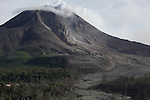 Sinabung Volcano with andesite lava dome at summit and lava flow deposit near evacuated village, Sumatra, Indonesia