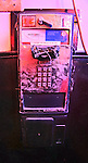A out of order public phone near the entrance to a restaurant in San Francisco Chinatown at night...