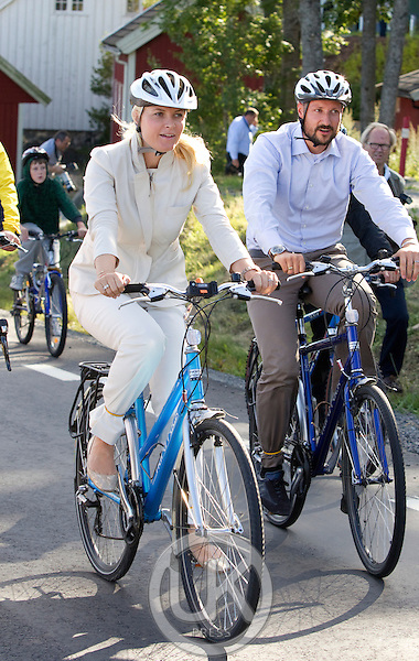 Crown Prince Haakon and Crown Princess Mette-Marit of Norway visit the town of Grimstad, and take a short bike ride, during a three day visit, to the county of Aust-Agder in Southern Norway