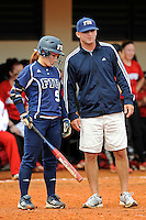 11 February 2012:  FIU Head Coach Jake Schumann speaks with Beth Peller (9) during a break in the action as the University of Louisville Cardinals defeated the FIU Golden Panthers, 4-2, as part of the COMBAT Classic at the FIU Softball Complex in Miami, Florida.