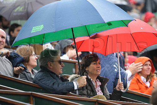 22.05.2016. Stade Roland Garros, Paris, France. Roland Garos French Open Tennis Day One.  Tennis fans take cover from the rain during the match between Simone Bolelli (ITA) and Kei Nishikori (5)(JPN).