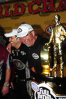 Nov 14, 2010; Pomona, CA, USA; NHRA top fuel dragster driver Larry Dixon (left) celebrates with team owner Alan Johnson after winning the 2010 top fuel championship during the Auto Club Finals at Auto Club Raceway at Pomona. Mandatory Credit: Mark J. Rebilas-