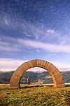 Andy Goldsworthy's Striding Arches sculptures on Bail Hill looking up Dalwhat glen to Cairnhead hill walking walker enjoying the view Dumfries and Galloway Scotland UK