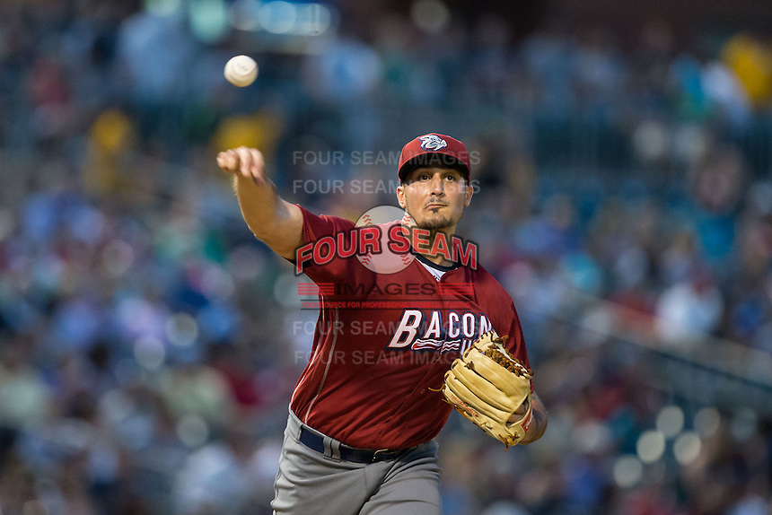 Lehigh Valley Iron Pigs starting pitcher Zach Eflin (16) makes a pick-off throw to first base against the Charlotte Knights at BB&T BallPark on June 3, 2016 in Charlotte, North Carolina.  The Iron Pigs defeated the Knights 6-4.  (Brian Westerholt/Four Seam Images)