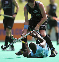 NZ's Bradley Shaw stands over Vikram Pillay after a collision during the international hockey match between the New Zealand Black Sticks and India at National Hockey Stadium, Wellington, New Zealand on Saturday, 20 February 2009. Photo: Dave Lintott / lintottphoto.co.nz