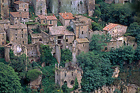 Houses hang onto the steep cliffs of SORANO,  a MEDIEVAL HILL TOWN with a 15th Cent. Palace & Castle - TUSCANY, ITALY