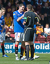 RANGERS' KYLE LAFFERTY TRIES TO SWEET TALK REFEREE CRAIG THOMSON INTO NOT SHOWING HIM A YELLOW CARD