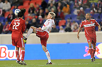 John Wolyniec (15) of the New York Red Bulls and Wilman Conde (22) of the Chicago Fire go for the ball during the second half of a Major League Soccer match between the New York Red Bulls and the Chicago Fire at Red Bull Arena in Harrison, NJ, on March 27, 2010. The Red Bulls defeated the Fire 1-0.
