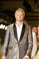 Montreal (Qc) CANADA, August 5, 2007 -<br /> <br /> Jonas BJORKMAM ( Finland 27)<br /> Tennis Players wears an ENVERS creation by Yves-Jean Lacasse in a benefit  fashion show  for Young Tennis, August 5th 2007, at the Queen Elizabeth Hotel in Montreal.