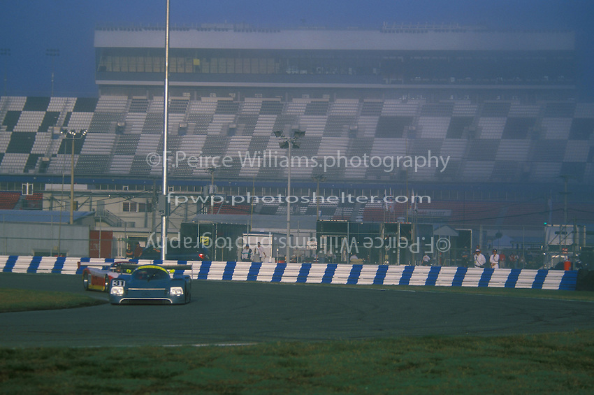 Vintage machines run in the early morning fog...2002 Rolex 24 at Daytona, Daytona International Speedway, Daytona Beach, Florida USA Feb. 2002.(Sports Car Racing)