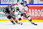 S&ouml;dert&auml;lje 2014-01-06 Ishockey Hockeyallsvenskan S&ouml;dert&auml;lje SK - Malm&ouml; Redhawks :  <br />  Malm&ouml; Redhawks Bj&ouml;rn Svensson i kamp om pucken med  med S&ouml;dert&auml;ljes Jason Gregoire <br /> (Foto: Kenta J&ouml;nsson) Nyckelord: