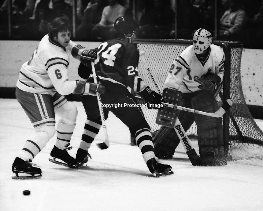 Seals vs Pittsburg Penguins 1975. Seals Len Frig , and goalie Gilles Meloche, Penguins Mario Faubert. (photo/Ron Riesterer)