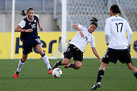 US's Yael Averbuch fights for the ball with Germany's Dzsenifer Marozsan during their Algarve Women's Cup soccer match at Algarve stadium in Faro, March 13, 2013.  .Paulo Cordeiro/ISI