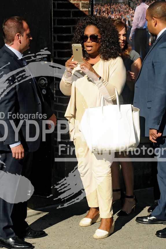 Oprah Winfrey arrives for the 'Late Show with David Letterman' at the Ed Sullivan Theater in New York on May 14, 2015