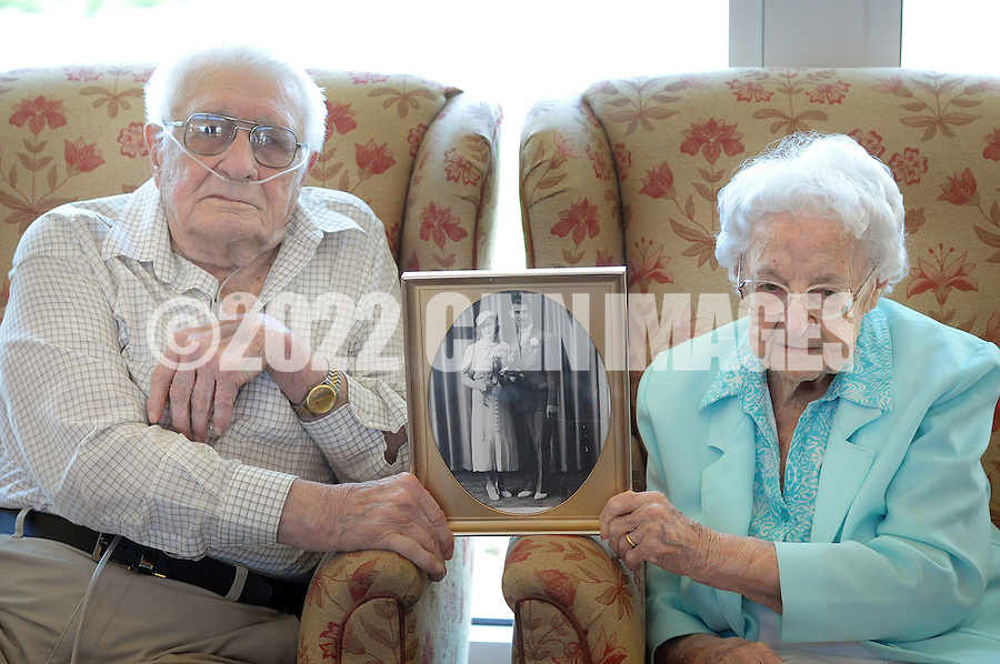 Harvey Kratz, 97, and Mae Kratz, 96 hold a photograph of themselves from their wedding day as they chat about lengthy, happy marriage Sunday April 17, 2016 in Hatfield, Pennsylvania. They celebrate their 80th wedding anniversary on Monday April 18th, 2016. The couple has 3 children, 9 grandchildren, 16 great grandchildren and 6 great great grandchildren. (Photo by William Thomas Cain)