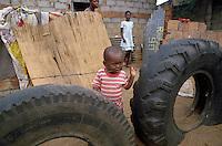 - child in the shantytown of Barrio Mulene, at the periphery of Maputo....- bambino nella bidonville di Barrio Mulene, alla periferia di Maputo