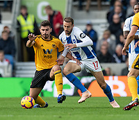 Brighton &amp; Hove Albion's Glenn Murray (right) vies for possession with Wolverhampton Wanderers' Ruben Neves (left) <br /> <br /> Photographer David Horton/CameraSport<br /> <br /> The Premier League - Brighton and Hove Albion v Wolverhampton Wanderers - Saturday 27th October 2018 - The Amex Stadium - Brighton<br /> <br /> World Copyright &copy; 2018 CameraSport. All rights reserved. 43 Linden Ave. Countesthorpe. Leicester. England. LE8 5PG - Tel: +44 (0) 116 277 4147 - admin@camerasport.com - www.camerasport.com