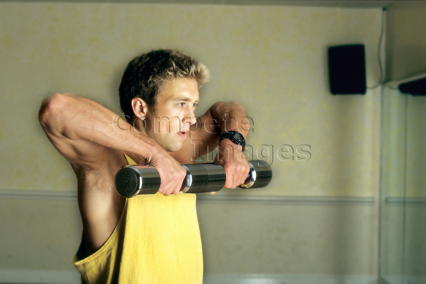 Man exercising with hand weights