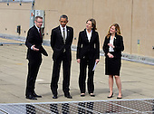 United States President Barack Obama looks at solar panels installed on the roof of the U.S. Department of Energy in Washington, D.C. on Thursday, March 19, 2015.  From left to right: Eric Haukdal, Department of Energy Energy Manager, The President, Liz Sherwood-Randall, Deputy Secretary of Energy, and Kate Brandt, Federal Chief Sustainability Officer.<br /> Credit: Ron Sachs / Pool via CNP