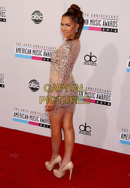 Kimberly Cole.40th Anniversary American Music Awards - Arrivals held at Nokia Theatre L.A. Live, Los Angeles, California, USA..November 18th, 2012.AMA AMAs full length dress side looking over shoulder pink white sheer embellished jewel encrusted hair up braid plait looking over shoulder .CAP/ADM/RE.©Russ Elliot/AdMedia/Capital Pictures.
