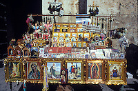 Religious parafanelia for sale outside of a church. Real de Catorce, Mexico